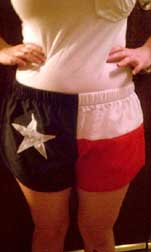 model wearing Texas flag shorts
